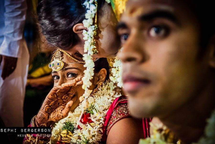 During a wedding in Chennai, I could see the bride was going to cry so I picked up my second camera with 35mm lens and waited for this shot to happen. A split second later she wiped the tear and was smiling again. (Nitya & Sharath's Tamil-Brahmin wedding in Chennai)