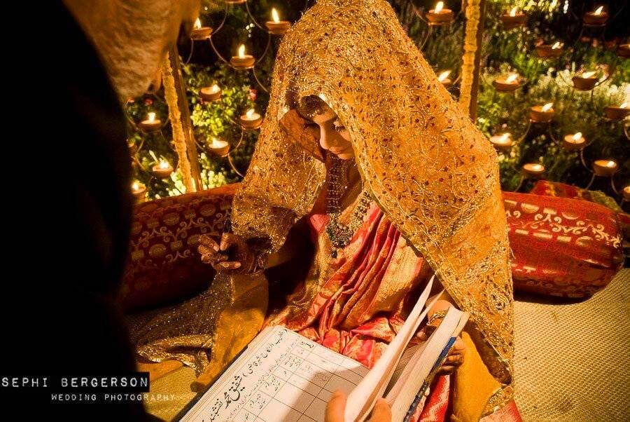 A muslim bride signs the Nikha in front of the mulah. The bridesgroom signs the Nikah separately and then the couple are pronounced married. The entire ceremony took one minute and the wedding was over. (Aashti & Zahid's Muslim wedding in Delhi)