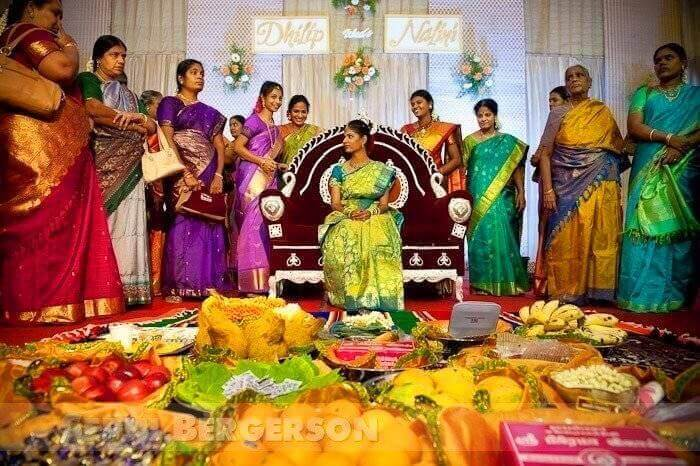 The bride with all her gifts, surrounded by women from the bridegroom's family