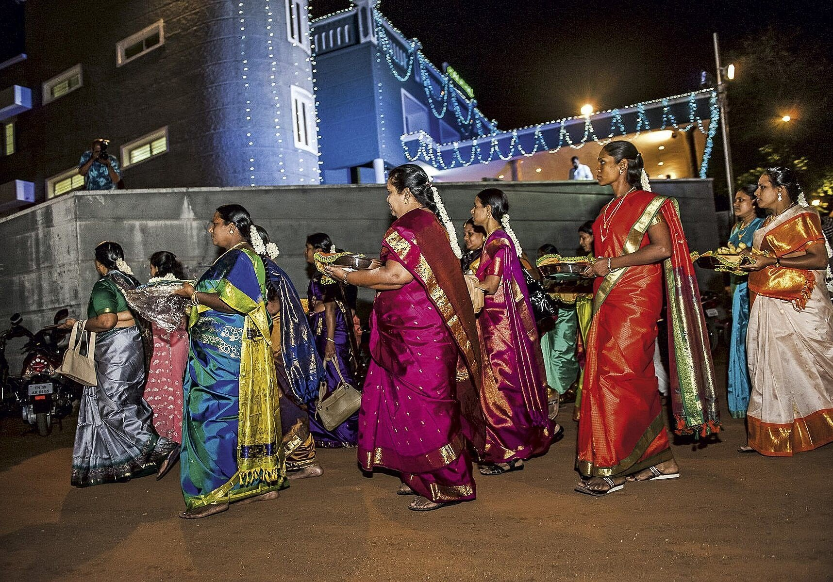 Women from the bridegroom's family bring gifts for the bride as part of the betrothal ceremony before a south Indian wedding at the holy city of Madurai. Tamil Nadu, 2009